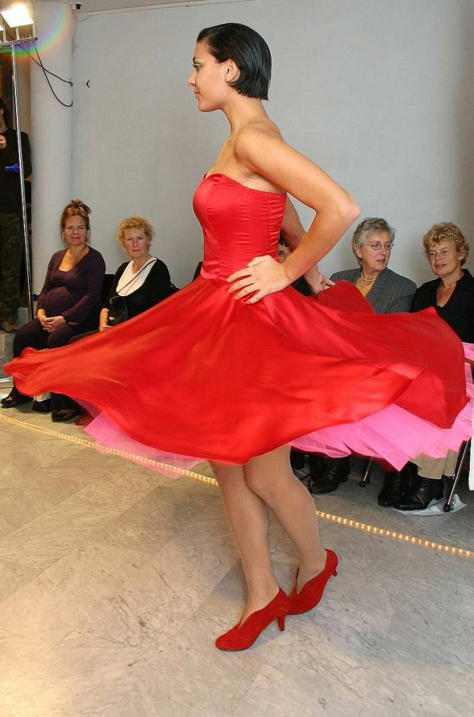 Red short party or cocktail dress with petticoat