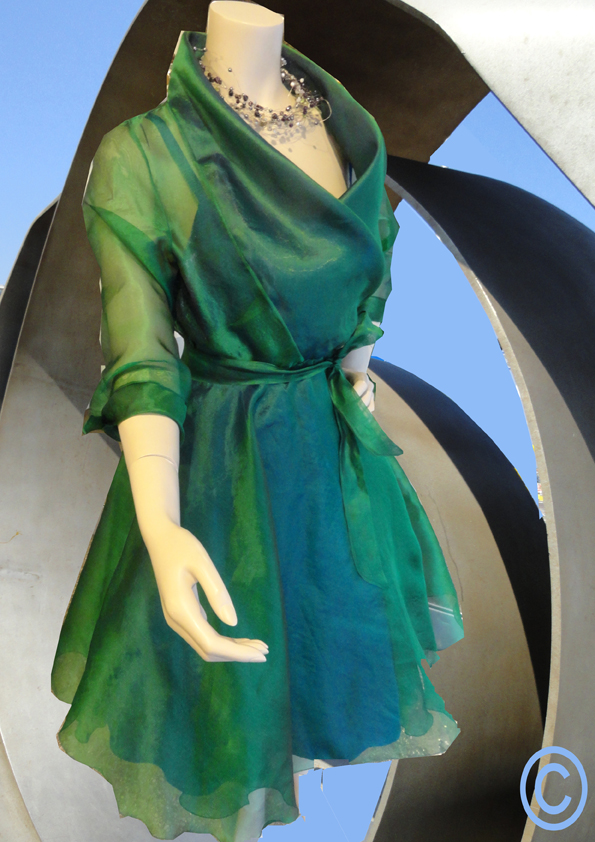Wrap around dress of green organza silk