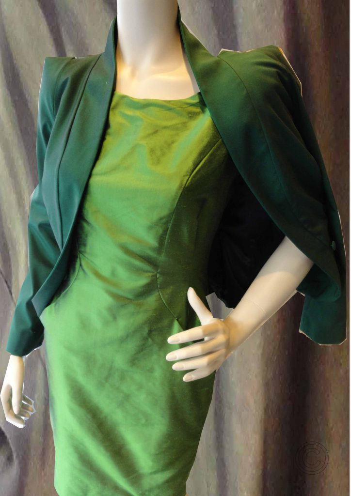 Green dress of silk and dark green jacket