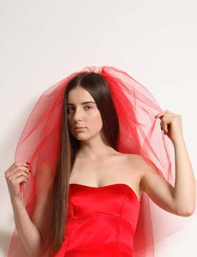 Red strapless top with veil of tule