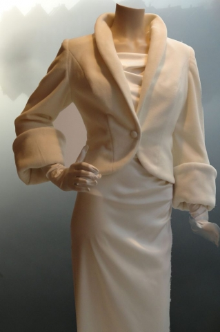 Jacket of ivory wool on a long weddingdress